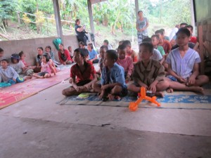 """All the children sitting after learning to sing """"Father Abraham""""."""
